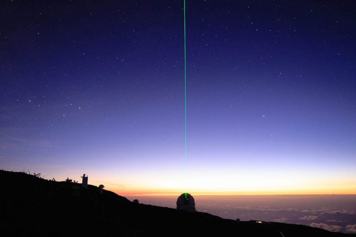 View of the Observatory at sunset with William Herschel Telescope and its green laser, La Palma